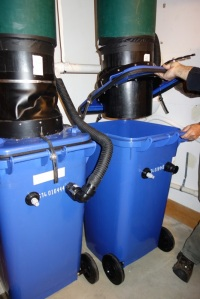 Fig. 2: Installation of a new empty bin to the chute